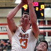 Jeff Krage – For Shaw Media<br /> St. Charles East's Dave Mason takes a shot during Saturday's game against visiting St. Charles North.<br /> St. Charles 1/18/14
