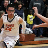 Jeff Krage – For Shaw Media<br /> St. Charles East's Zach Manibog is guarded by St. Charles North's Johnny Davern during Saturday's game.<br /> St. Charles 1/18/14