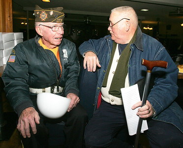 H. Rick Bamman - hbamman@shawmedia.com Korean War veteran Charles Mathey, (left) of Woodstock and Army veteran Bob Poyner catch up with each other at the Veterans Stand Down held at the Woodstock VFW Wednesday, Jan. 22, 2013.