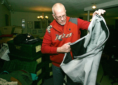 H. Rick Bamman - hbamman@shawmedia.com Army veteran William Brandt of Hebron tries on a new jacket at the McHenry County Veterans Stand Down on Wednesday, Jan. 22 in Woodstock. The event held at the Woodstock VFW offered donated clothing items to veterans in addition to other veterans services.