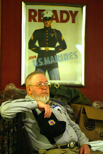 H. Rick Bamman - hbamman@shawmedia.com Volunteer  Donald Stage of Woodstock waits to asset veterans with clothing.