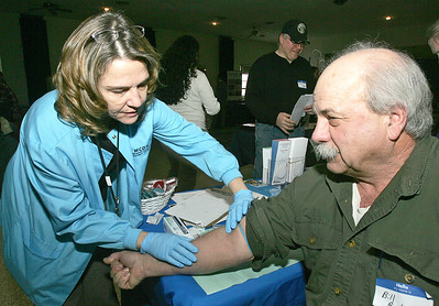 H. Rick Bamman - hbamman@shawmedia.com Army veteran and event volunteer Bill Richards of McHenry has blood drawn by Susan Karras a McHenry County Health Department nurse.