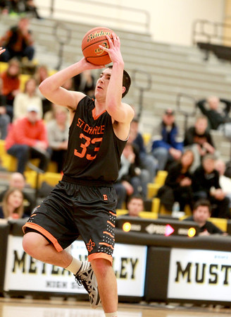 Jake Asquini of St. Charles East attempts a shot during their game at Metea Valley Thursday.