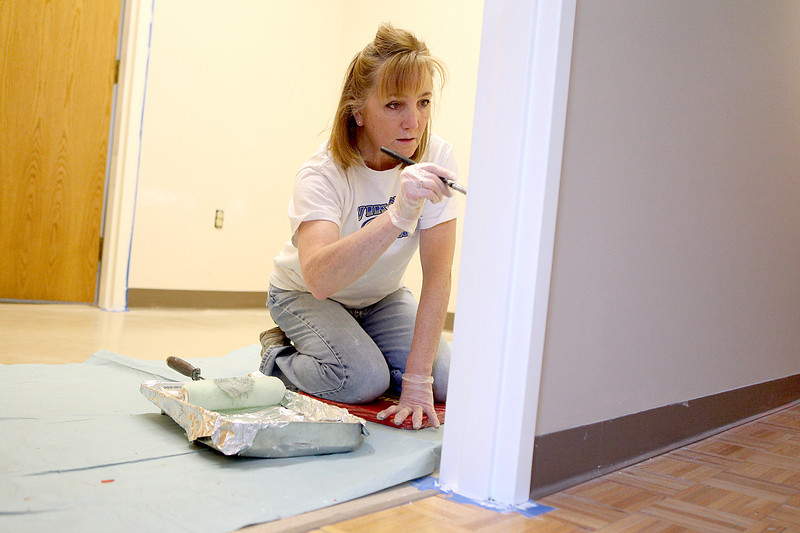 Heidi Howlett, museum educator at the Geneva History Center, paints an office area Thursday morning. The Geneva History Center will also be changing their name to the Geneva History Museum and will celebrate 10 years at their Third Street location with a gala in May.