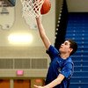 Cole Navigato goes up for a shot during freshman boys basketball practice at Geneva High School Tuesday afternoon.