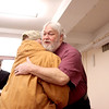 Batavia resident John Carr (right) hugs Kendall County Superintendent Ed Dixon before a ceremony naming him Illinois Veteran of the Month Wednesday morning at the Kane County Government Center in Geneva. Carr, who joined the Army in 1969, began working for the Veterans Assistance Commission of Kane County as a hospital caseworker in 1974.