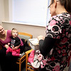 Stephanie McGlennon of Batavia, with her daughter, Serena, 10 months, talks with Stephanie Farrell, RN, after Serena received a flu shot at the Cadence Health Vaccination Clinic at Delnor Hospital in Geneva Thursday.