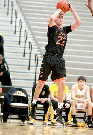 St. Charles East's James McQuillan gets a shot up during their game at Metea Valley Thursday.
