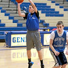 Devin Navigato shoots as his cousin, Blake, runs by during freshman boys basketball practice at Geneva High School Tuesday afternoon.