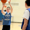 Blake Navigato shoots during freshman boys basketball practice at Geneva High School Tuesday afternoon.