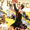 St. Charles East's Cole Gentry gets a shot up during their game at Metea Valley Thursday.