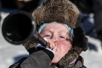 Sarah Nader- snader@shawmedia.com Bridget Trainor, 9, of Barrington blows her horn while watching the 109th Norge Ski Jump Tournament at the Norge Ski Club in Fox River Grove Saturday January 25, 2014.