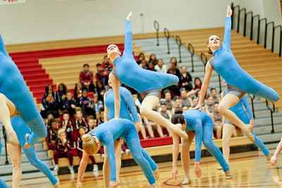 Ruthie Hauge - For Shaw Media Barrington High School Poms Squad dancers Amanda Adams (so.) and Madeline Cremer (jr.) leap into the air while performing a lyrical dance piece during the IHSA Competitive Dance Regional at Huntley High School on Saturday, January 25, 2014.