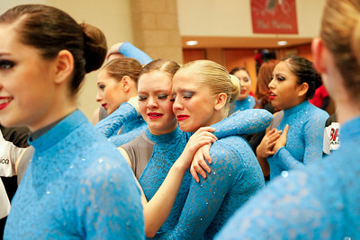 Ruthie Hauge - For Shaw Media Barrington High School Poms Squad dancers Eva Dockery (sr.) and Melissa Stathakis (sr.) share an emotional embrace after performing at the IHSA Competitive Dance Regional at Huntley High School on Saturday, January 25, 2014.