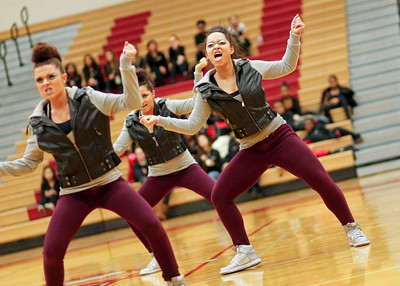 Ruthie Hauge - For Shaw Media Huntley High School Poms Squad dancers, Eliza Godfrey (so.) and Amina Hasan (so.) perform with their team during the IHSA Competitive Dance Regional at Huntley High School on Saturday, January 25, 2014.