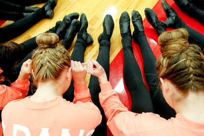 Ruthie Hauge - For Shaw Media Crystal Lake Central Poms dancers lock pinkie fingers with each other as they await the announcement of scores after walk competing in the IHSA Competitive Dance Regional at Huntley High School on Saturday, January 25, 2014.