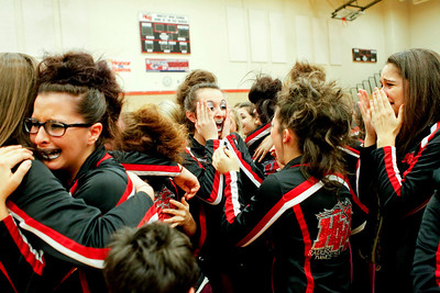 Ruthie Hauge - For Shaw Media Huntley High School Poms Squad dancers, Victoria Oliveira (sr.) and Rachel Grano (jr.) react after learning their team took first place during the IHSA Competitive Dance Regional at Huntley High School on Saturday, January 25, 2014.