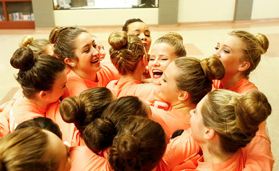 Ruthie Hauge - For Shaw Media Crystal Lake Central Poms Squad dancers hug fellow teammate Allison Beggin (sr) after competing in the IHSA Competitive Dance Regional at Huntley High School on Saturday, January 25, 2014.  Beggin suffered an ankle injury, but still competed.