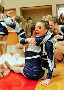 Ruthie Hauge - For Shaw Media Cary-Grove High School varsity poms member Haley Pennington (jr.) hugs teammate Riley Dahl (sr) when they learn they are moving on to the state competition at the IHSA Competitive Dance Regional at Huntley High School on Saturday, January 25, 2014.