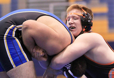 Candace H. Johnson - For Shaw Media McHenry's Ryan Grannemann, 17, tries to control Warren's Zach Khoury, 15, during their 195-pound match at Warren Township High School in Gurnee. Warren's Zach Khoury won the match 7-2.