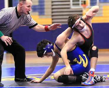 Candace H. Johnson - For Shaw Media Pat Wood, of Crystal Lake, wrestling official, gets close to the action during Warren's Juan Toledo and McHenry's Robert Nagel, both 17, 132-pound match at Warren Township High School in Gurnee. McHenry's Robert Nagel won 6-0.