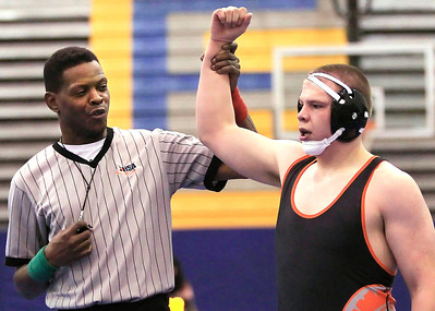 Candace H. Johnson - For Shaw Media Ellis Swopes, of Waukegan, wrestling official, shows McHenry's Joshua Little as the winner of his wrestling match against Grayslake Central's Tristan Suasin, both 16, during their 220-pound match at Warren Township High School in Gurnee. McHenry's Joshua Little won 13-6.