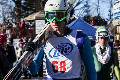 Sarah Nader- snader@shawmedia.com Slovenia skier David Krapez walks towards the jump during the 109th Norge Ski Jump Tournament at the Norge Ski Club in Fox River Grove Saturday January 25, 2014.
