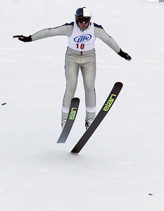 Sarah Nader- snader@shawmedia.com Norway skier Geir Vethe comes down the hill during the 109th Norge Ski Jump Tournament at the Norge Ski Club in Fox River Grove Saturday January 25, 2014.