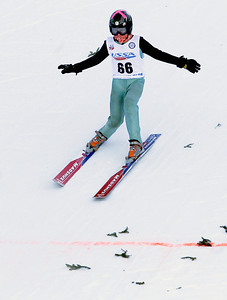 Sarah Nader- snader@shawmedia.com Lucas Nichols of the Norge Ski Club comes down the hill during the 109th Norge Ski Jump Tournament held at the Norge Ski Club in Fox River Grove Saturday January 25, 2014. The tournament continues through Sunday.