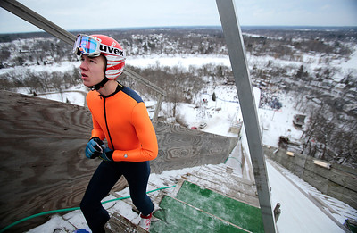 Kyle Grillot - kgrillot@shawmedia.com   Lasse Moilanen of Finland waits at the top of the tower  to jump during the 109th Norge Ski Jump Tournament held at the Norge Ski Club in Fox River Grove Sunday January 26, 2014.