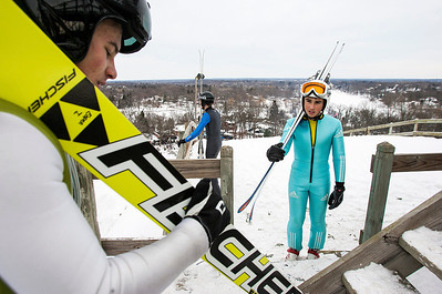 Kyle Grillot - kgrillot@shawmedia.com   Riders including Landon Liveri of the New York Ski Eduacational Foundation (right) prepare to ascend the 150-foot tower to jump during the 109th Norge Ski Jump Tournament held at the Norge Ski Club in Fox River Grove Sunday January 26, 2014.