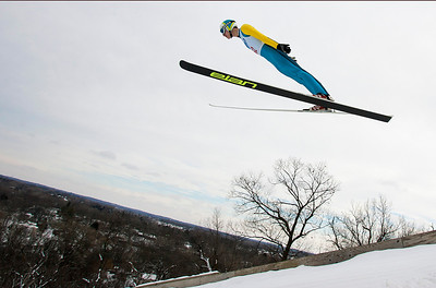 Kyle Grillot - kgrillot@shawmedia.com   Mikael Kveder of Slovenia is airborne during the 109th Norge Ski Jump Tournament held at the Norge Ski Club in Fox River Grove Sunday January 26, 2014.