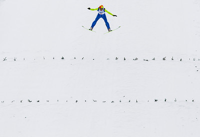 Kyle Grillot - kgrillot@shawmedia.com   Henry Kavanuagh-Beltman of the Mt. Itasca Ski Club is airborne during the 109th Norge Ski Jump Tournament held at the Norge Ski Club in Fox River Grove Sunday January 26, 2014.