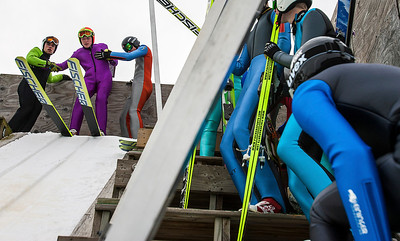 Kyle Grillot - kgrillot@shawmedia.com   Henry Kavanuagh-Beltman of the Mt. Itasca Ski Club (in purple) is helped by fellow skiers atop the 15-foot tower before launching during the 109th Norge Ski Jump Tournament held at the Norge Ski Club in Fox River Grove Sunday January 26, 2014.