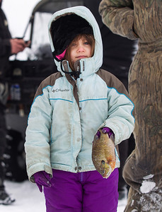 Kyle Grillot - kgrillot@shawmedia.com   Connie Fallon, 4, of Freeport holds her fish after having it measured during the Wonder Lake Sportsman & Conservation Club's 28th Annual Ice Fishing Derby on Wonder Lake Sunday January 26, 2014. The catch and release derby costs $10 per person above the age of 12 and prizes are awarded for the biggest fish of different varieties. All proceeds go towards the conservation of the lake.