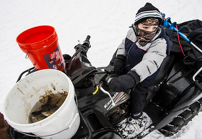 Kyle Grillot - kgrillot@shawmedia.com   Carter Thornton, 5, of McHenry waits on a four wheeler after measuring his catch during the Wonder Lake Sportsman & Conservation Club's 28th Annual Ice Fishing Derby on Wonder Lake Sunday January 26, 2014. The catch and release derby costs $10 per person above the age of 12 and prizes are awarded for the biggest fish of different varieties. All proceeds go towards the conservation of the lake.