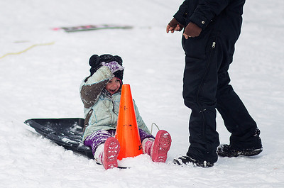 Kyle Grillot - kgrillot@shawmedia.com   Connie Fallon, 4, of Freeport reacts after running into a safety cone while sledding during the Wonder Lake Sportsman & Conservation Club's 28th Annual Ice Fishing Derby on Wonder Lake Sunday January 26, 2014. The catch and release derby costs $10 per person above the age of 12 and prizes are awarded for the biggest fish of different varieties. All proceeds go towards the conservation of the lake.