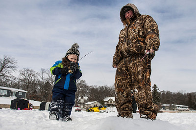 Kyle Grillot - kgrillot@shawmedia.com   His first time ice fishing, Connor Carlson, 3, fishes with his aunt Kate Fee of Wonderlake during the Wonder Lake Sportsman & Conservation Club's 28th Annual Ice Fishing Derby on Wonder Lake Sunday January 26, 2014. The catch and release derby costs $10 per person above the age of 12 and prizes are awarded for the biggest fish of different varieties. All proceeds go towards the conservation of the lake.