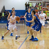 Marmion's Michael Sheehan (10) drives to the hoop against St. Francis' Zach Prociuk (right) at Marmion High School in Aurora , IL on Friday, January 24, 2014 (Sean King for Shaw Media)