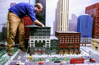 Sarah Nader- snader@shawmedia.com Master Model Builder David Howard of Crystal Lake fixes a piece in the Miniland Chicago exhibit at LEGOLAND in Schaumburg Tuesday, January 28, 2014. Howard is only one of six in the U.S. and 11 in the world with the title. He creates new models and exhibits at the center as his full-time job.