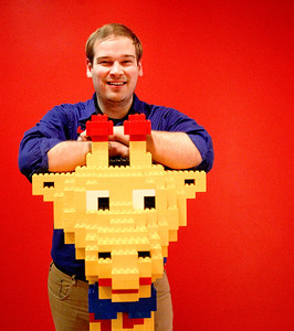 Sarah Nader- snader@shawmedia.com Master Model Builder of LEGOLAND David Howard of Crystal Lake poses with a giraffe at LEGOLAND in Schaumburg Tuesday, January 28, 2014. Howard is only one of six in the U.S. and 11 in the world with the title. He creates new models and exhibits at the center as his full-time job.