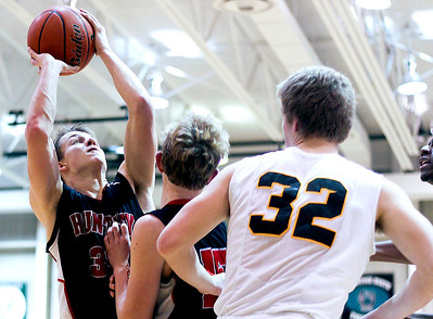 Sarah Nader- snader@shawmedia.com Huntley's Zach Gorney (left) shoots during the third quarter of Wednesday's game against Crystal Lake South January 29, 2014. Huntley defeated Crystal Lake South, 58-48.