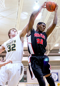 Sarah Nader- snader@shawmedia.com Crystal Lake South's Wes Buckner (left) and Huntley's Amanze Egekeze right for the rebound during the second quarter of Wednesday's game in Crystal Lake January 29, 2014. Huntley defeated Crystal Lake South, 58-48.