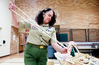 Sarah Nader- snader@shawmedia.com  Barb Majkrzek, assistant scout master for Troop 161, ties different knots with rope for an activity during Wednesday's troop meeting at Prairie Grove School January 29, 2014. Majkrzek has been involved in scouts for 18 years. She has helped guid several boys into becoming eagle scouts, even though her own kids have moved on from the scouts.