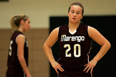 Kyle Grillot - kgrillot@shawmedia.com  Marengo senior Taylor Carlson (20) reacts after a foul was called on her during the second quarter of the girls basketball game Friday in Harvard. Harvard beat Marengo 43-41.