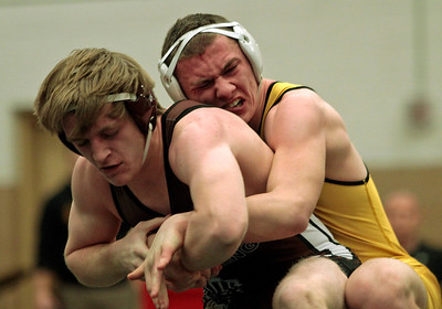 Kyle Grillot - kgrillot@shawmedia.com  Marengo's Kyle Gara wrestles Harvards Matthew Wheeler during the 160-pound match of the Castle Challenge Friday in Harvard. Harvard won the meet, 50-24.