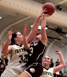 Kyle Grillot - kgrillot@shawmedia.com  Marengo senior Lynsey Hoeske (3) puts up a shot under pressure from Harvard senior Abby Linhart (32) during the third quarter of the girls basketball game Friday in Harvard. Harvard beat Marengo 43-41.