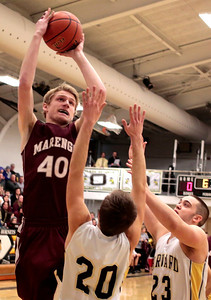 Kyle Grillot - kgrillot@shawmedia.com  Marengo senior Andrew Volkening (40) puts up a shot under pressure from Harvard seniors Zach Martin (20) and Tate Miller (23) during the first quarter of the boys basketball game of the Castle Challenge Friday in Harvard. Marengo beat Harvard 54-45.