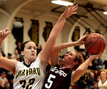 Kyle Grillot - kgrillot@shawmedia.com  Marengo senior Nikki Hammortree (5) puts up a shot under pressure from Harvard senior Abby Linhart (32) during the fourth quarter of the girls basketball game Friday in Harvard. Harvard beat Marengo 43-41.