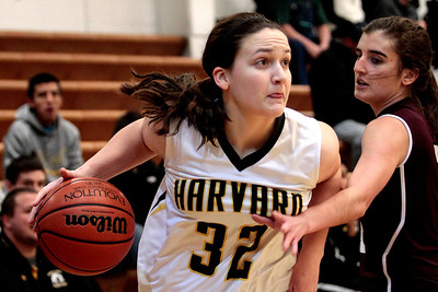 Kyle Grillot - kgrillot@shawmedia.com  Harvard senior Abby Linhart (32) goes to put up a hot under pressure from Marengo junior Rachel Tautges (2) during the first quarter of the girls basketball game Friday in Harvard. Harvard beat Marengo 43-41.